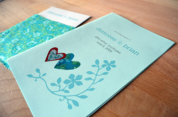 Wedding program with flower and fabric motif and invitation